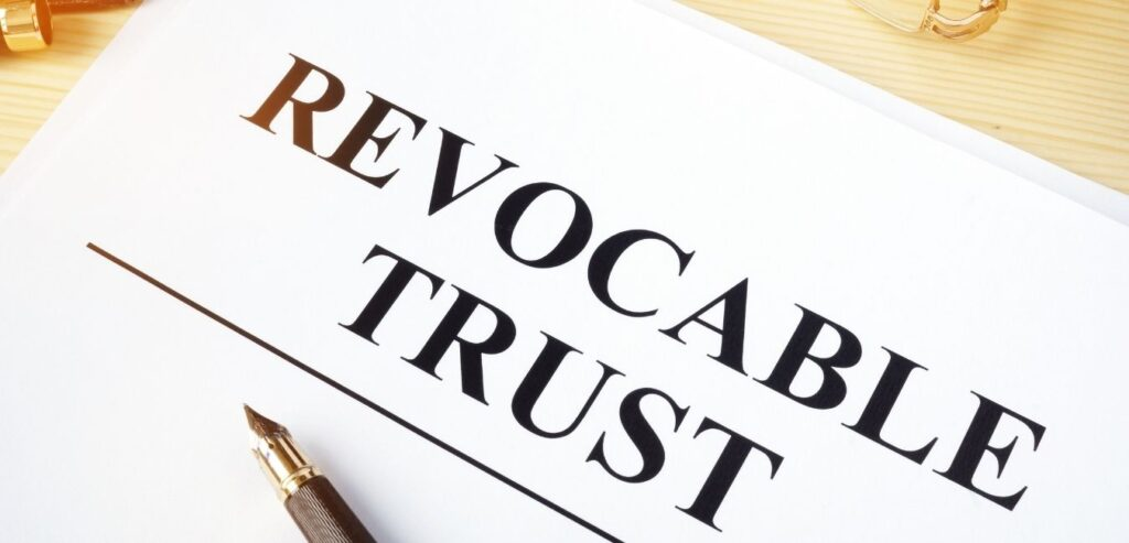 Revocable trust on a wooden desk representing trusts and estate planning.