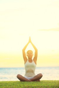 Good health. Yoga woman relaxing by sea